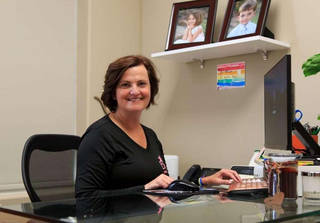 Dr. Blume at her desk - Blume Pediatric Dentistry San Antonio, TX